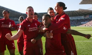 Georginio Wijnaldum celebrates after scoring Liverpool's opener in the 57th minute of their crucial win at Cardiff City.