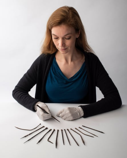 Kate Sumnall with a selection of Roman writing instruments that feature in the exhibition.