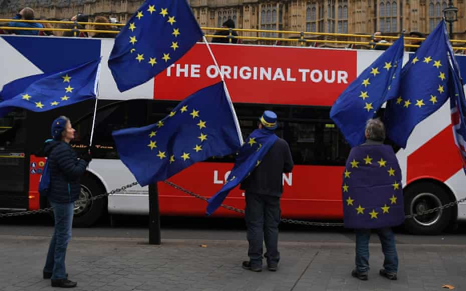 Anti-Brexit protesters wave EU flags outside parliament in London.