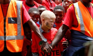 Pretoria, South Africa. Marshals keep watch over supporters of the EFF party before the launch of its election manifesto in Soshanguve