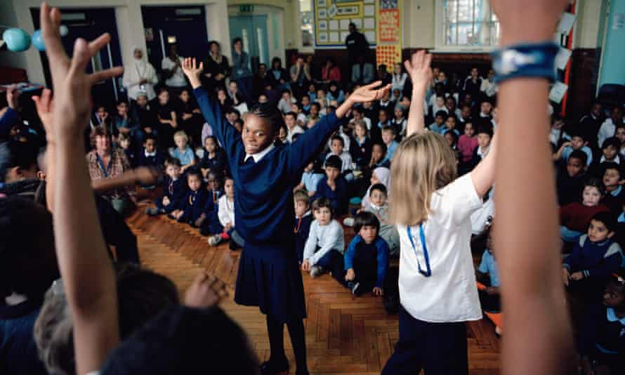 Pupils at Millfields community school in London perform an African dance during a school assembly as part of Black History Month.