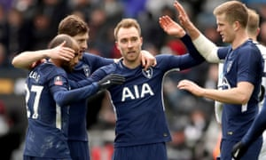 Christian Eriksen is congratulated after scoring his second goal and Spurs' third.