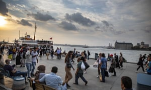 People are seen around the Kadikoy quay during the evening hours in Istanbul's Kadikoy district.