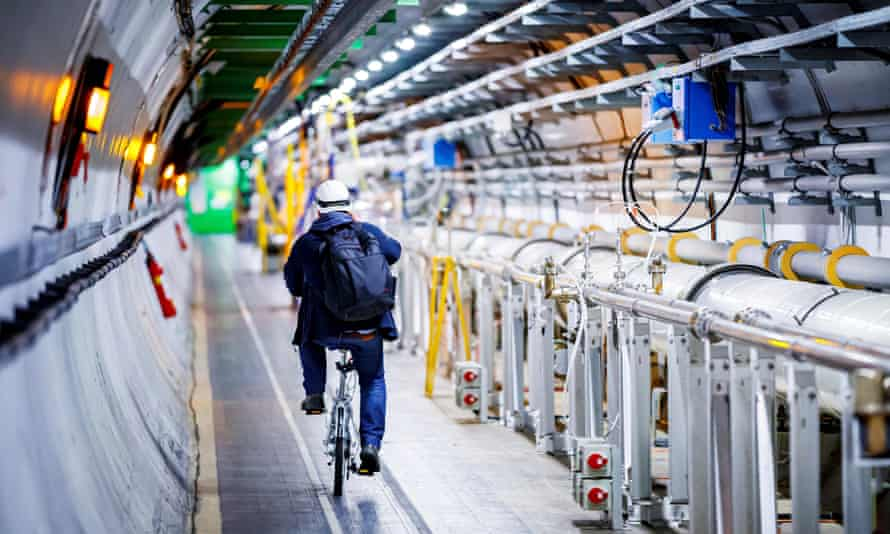 A man rides his bicycle along the beam line of the Large Hadron Collider.