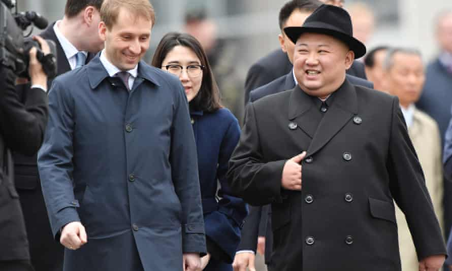 Russia's Far East development minister, Alexander Kozlov, welcomes Kim.