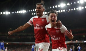 Pierre-Emerick Aubameyang (left) and Mesut Ozil have helped Unai Emery's Arsenal to a 16-game unbeaten run.