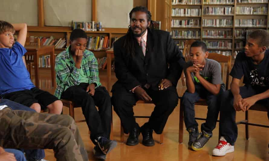 Life lessons: educator and youth advocate Ashanti Branch discusses feelings with a group of teenage boys.