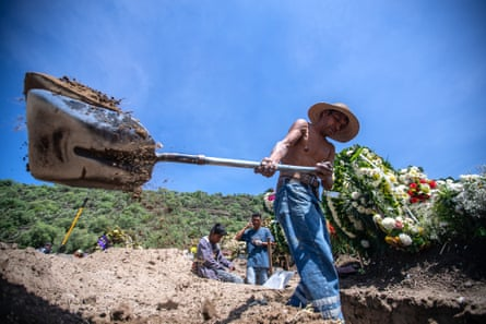 Gravediggers work digging several graves at the same time due to high demand during the pandemic at the San Miguel Xico cemetery in Valle de Chalco.