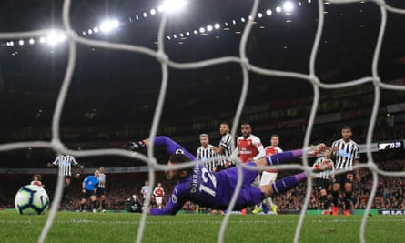 Aaron Ramsey slots the ball past Martin Dubravka for Arsenal's opener.