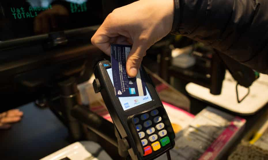 A customer uses a credit card to make a contactless payment