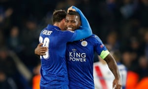 Wes Morgan and Christian Fuchs celebrate at the end of the match.