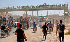 People protest against the Syrian regime and Russia in the rebel-held town of Maarrat al-Numan in the north of Idlib province