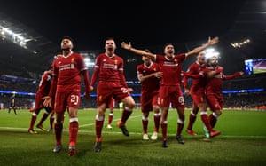 The Liverpool players celebrate Salah's goal.