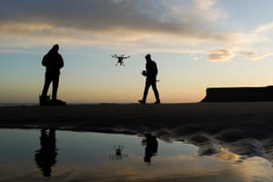 Saltburn By The Sea, Two men fly drones at sunrise