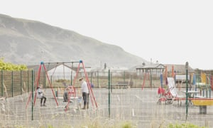 Julia Walker and her children in the playground in Fairbourne