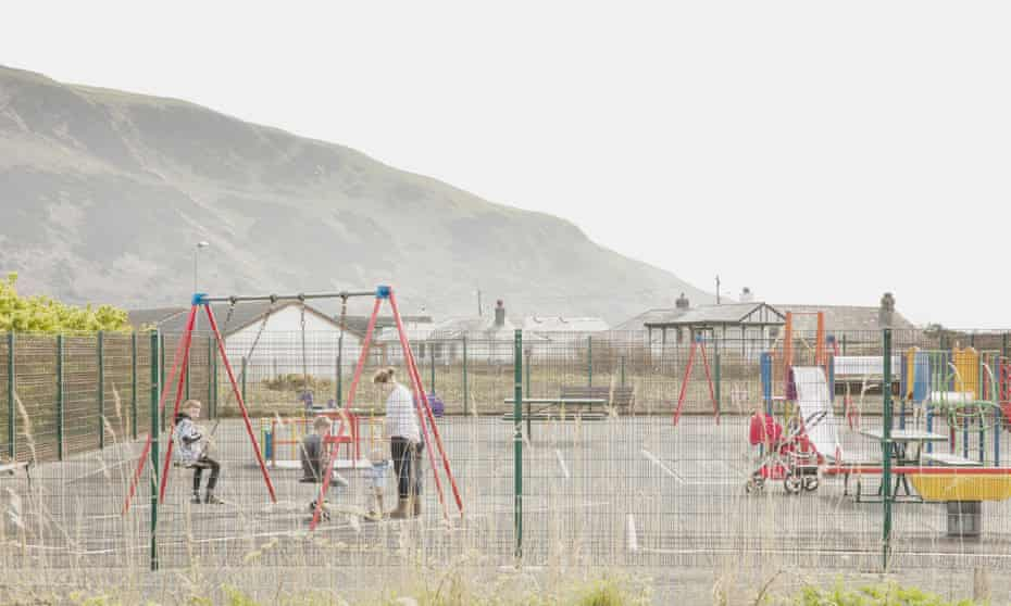 Julia Walker and her children in the playground in Fairbourne