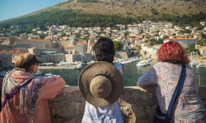 Guests admire the Dubrovnik coastline and harbour.