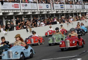 Children take part in a race at the Goodwood Revival in Goodwood, England
