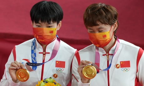 Olympic cyclists escape with warning after wearing Chairman Mao badges