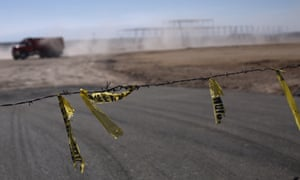 Barbed wire surrounds the site of a cancelled Ford auto manufacturing plant outside San Luis Potosi, Mexico Wednesday.
