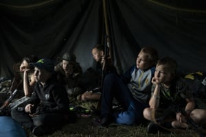 Children with rifles attend a summer camp organised by the nationalist Svoboda party in a village near Ternopil