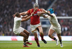 Jonathan Davies is tackled by Jonathan Joseph and Jack Nowell.