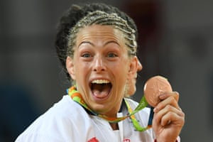 Bronze medallist Great Britain's Sally Conway celebrates on the podium of the women's -70kg judo contest of the Rio 2016 Olympic Games in Rio de Janeiro on August 10, 2016. / AFP PHOTO / Toshifumi KITAMURATOSHIFUMI KITAMURA/AFP/Getty Images