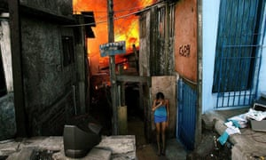 A woman cries after fleeing a fire in the periferia of São Paulo, Brazil on 30 August 2004.