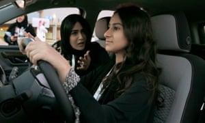 A woman sits behind the wheel during a car show only for women in Riyadh, Saudi Arabia