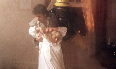 Kevin Webster (Michael Le Vell) rescuing Bet Lynch (Julie Goodyear) from the fire at the Rovers Return in 1986.