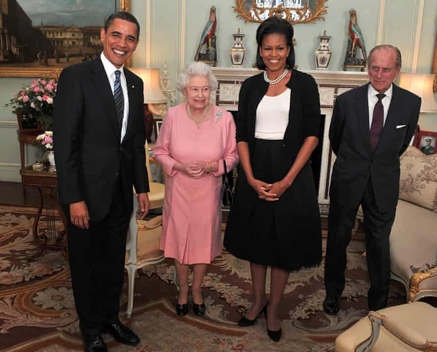 Michelle Obama wearing a black cardigan to meet the Queen and Prince Philip with Barack in 2009
