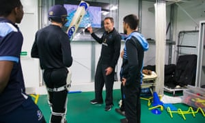 Richard Halsall guides young cricketers at Sussex's indoor facility using the coaching app he has designed.