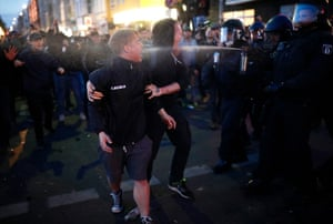 Police use pepper spray during a May Day demonstration in Berlin organised by leftist groups.
