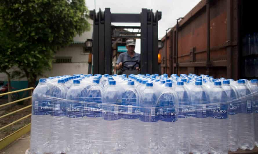 Bottled water shipped in for Rio Doce villagers