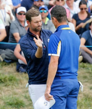 Team USA's Webb Simpson shakes hands with Team Europe's Justin Rose