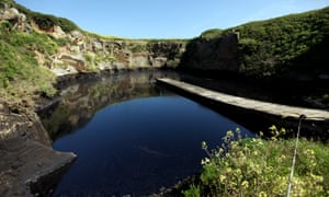 An old quarry pumped full of oil