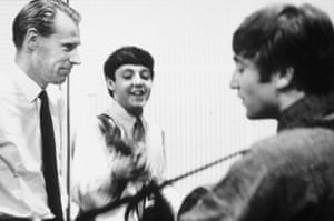 McCartney and Lennon with Martin in 1964.