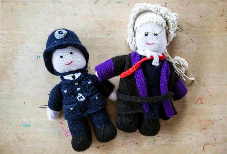 Knitted doll figures of a policeman and judge used by intermediaries who help children give evidence