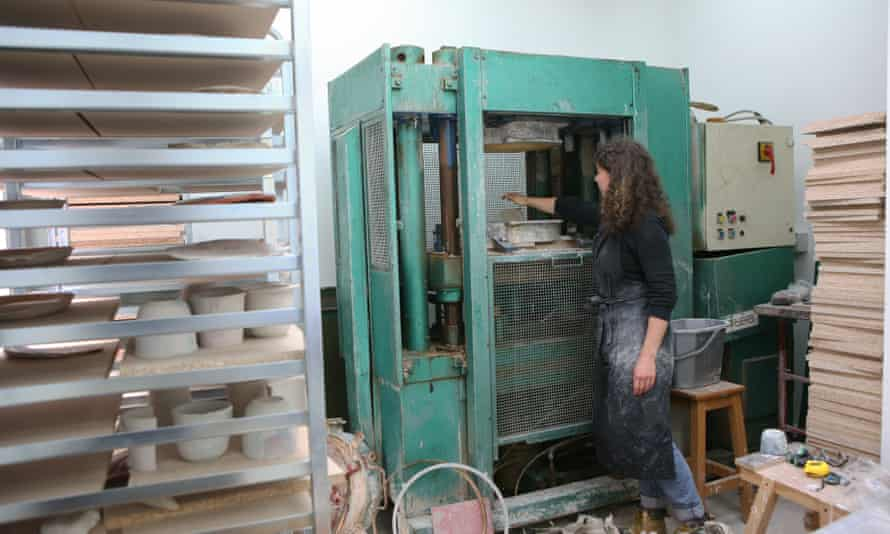 Anna Johnston adding clay to the press prior to creating a splatware plate