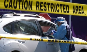 A driver is tested in Washington state where eight more exercise on the beach in Santa Monica, California, where the state governor has warned 25.5m people could contract coronavirus.