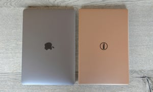 Apple's MacBook Pro and Dell's XPS 13 side by side