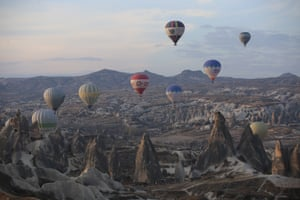 A drone photo shows a view of hot air balloons gliding over the Göreme district at the Cappadocia region, a Unesco world heritage site