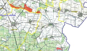 Map showing minefields marked in red near Tovarnik where thousands of migrants have gathered