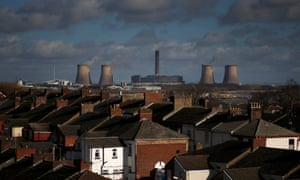 Fiddler'ss Ferry coal-fired power station rises above the rooftops of houses in Widnes, northern England.