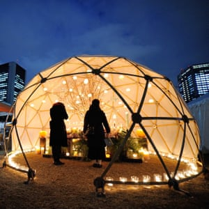 People pray in a dome in downtown Tokyo , as they pay tribute to people who died