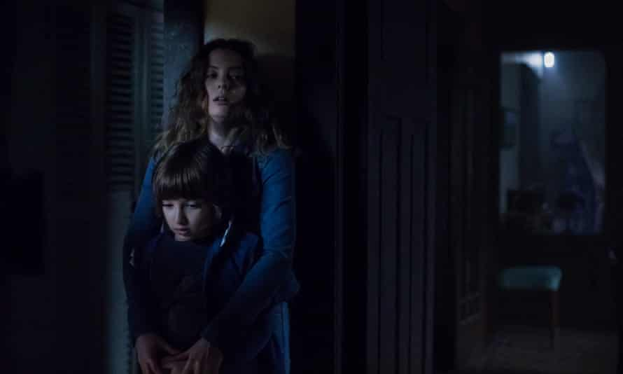 Feigning fear ... Azhy Robertson (front) and Gillian Jacobs in Come Play.