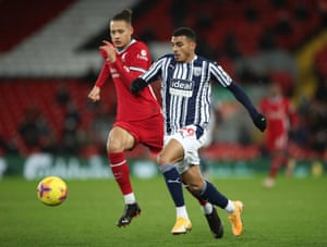 West Bromwich Albion's Karlan Grant beats Liverpool's Rhys Williams to the long ball.