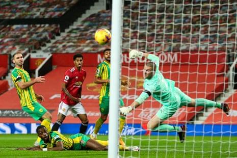 Johnstone denies Marcus Rashford during their recent game at Old Trafford.