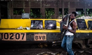 Artists and squatters worked together to transform an old railway running shed into the site of Nigeria's first biennial art exhibition, called Living on the Edge.