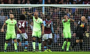 Manchester City players look dejected after Fabian Delph misses a chance on his return to Aston Villa.